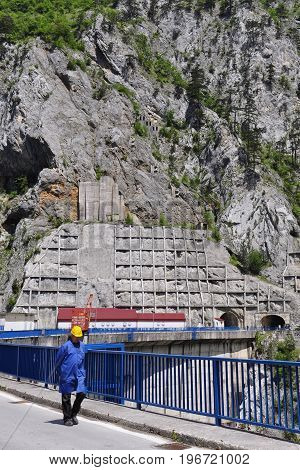 Martinovski HPP Montenegro - May 31 2014: The employee - engineer to work on hydroelectric Martinovski which is on the river of Piva