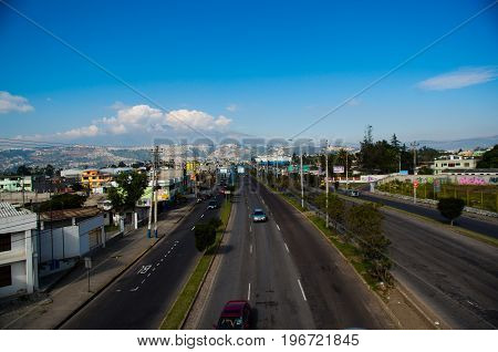 QUITO, ECUADOR- MAY 23, 2017: Main avenue, highway with cars on the road in the city of Quito.