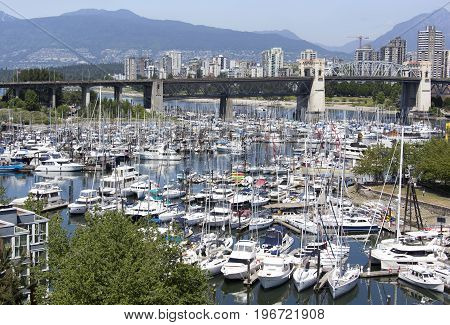 The marina view with Burrard Bridge over False Creek and Vancouver downtown skyline in a background (British Columbia).