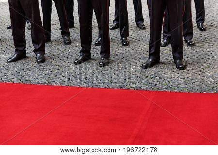Legs Of Guard Of Honor And Red Carpet
