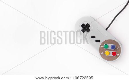 Gray retro joystick on a white background. Video game console GamePad on a white background. Copy space