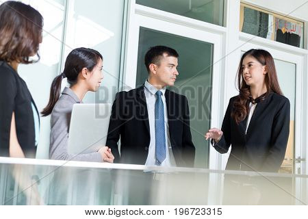 Asian Business people discuss in office