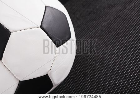 Soccer ball on black background. Playing football, active lifestyle concept