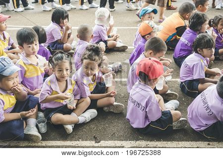 Trang Thailand - June 23 2017 : Kindergarten children waiting for enjoy activity on sports day at public ground in Trang Thailand