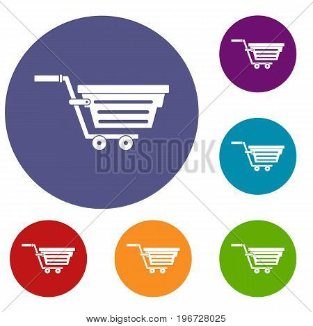 Shopping basket on wheels icons set in flat circle red, blue and green color for web