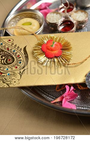 Rakhi -  A symbolic wrist band sister ties to brother to show love and respect. An indian tradition.