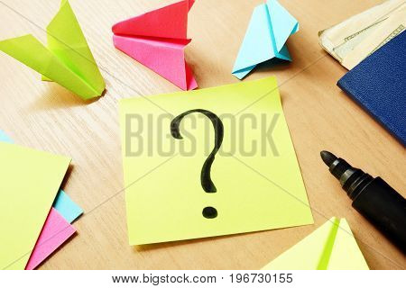 Traveling concept. Colorful paper planes and stick with question mark.
