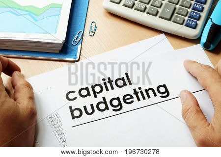 Papers with title capital budgeting. Business concept.