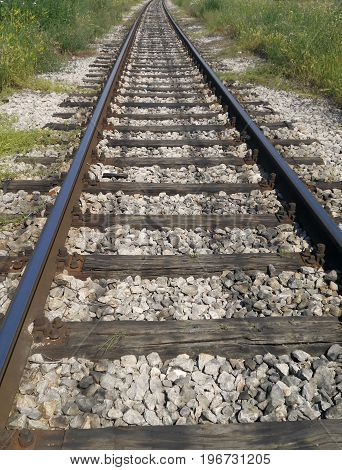 Old rail road that go directly to the horizon