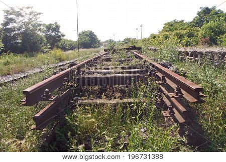 Throat sleepers and rusted rails of railway tracks, the remains of the old railway