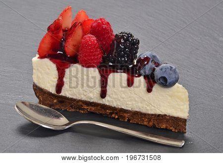 Cheese cake fruit ingredients and teaspoon.