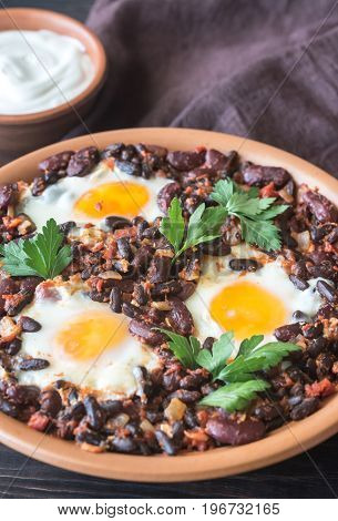 Bowl Of Chipotle Bean Chili With Baked Eggs