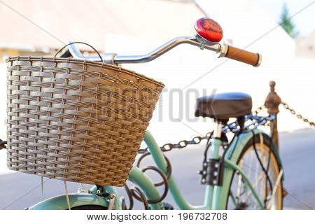 Close up picture of vintage bike with shopping basket parked on a sideway in Hungary Europe
