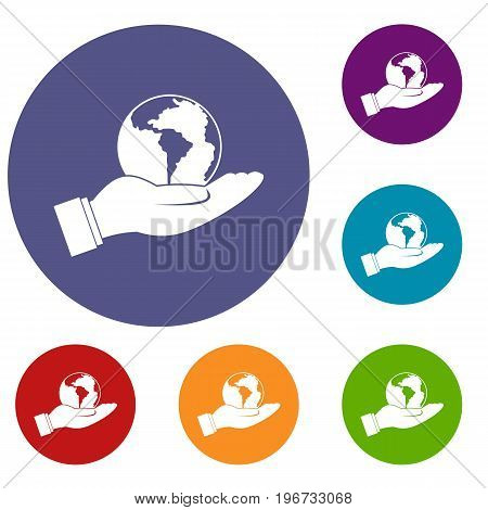 World planet in man hand icons set in flat circle red, blue and green color for web