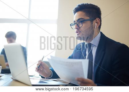 Businessman negotiating with partner through video-chat