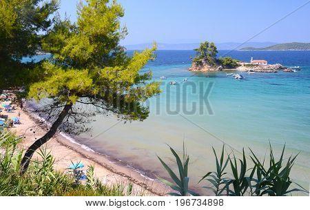 Beautiful view on small island with church Agios Nikolaos near Ellinika beach, Euboea- Greece