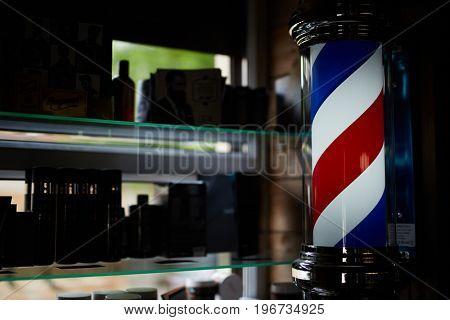 Barbershop pole inside modern hair salon