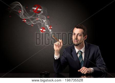 Businessman smoking with colored no smoking symbols nearby.