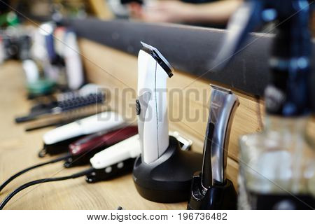 Set of haircutting machines on workplace of barber