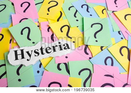 Hysteria Syndrome text on colorful sticky notes Against the background of question marks