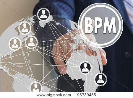 Businessman Pushes A Button Bpm, Business Process Management On The Touch Screen With A Futuristic B