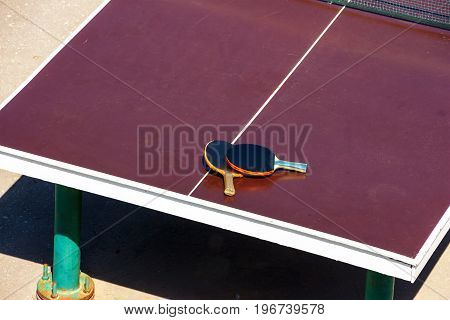 Rackets for table tennis, ping-pong are on the table