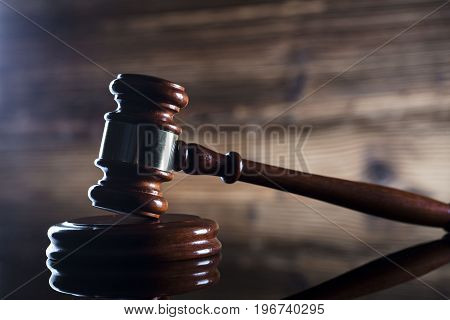 Mallet of the judge. Wooden background. Place for text.