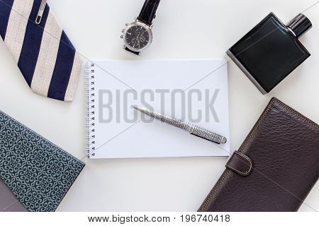 Man set: watch tie tie clip pen perfume wallet and notepad Top view Copy space White background