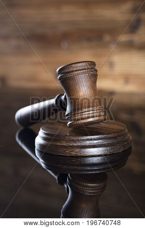 Law theme.  Gavel on the wooden background.