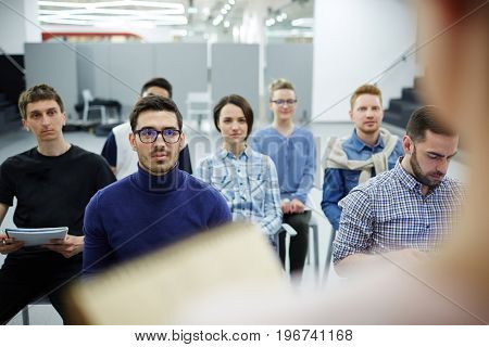 Group of students listening to teacher at seminar