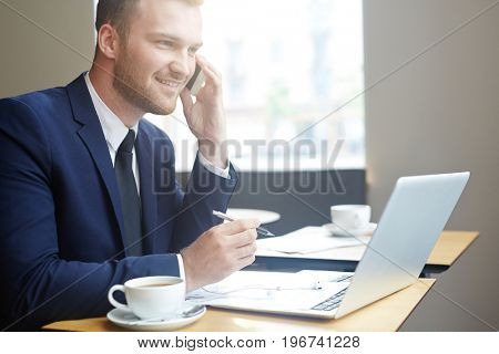 Confident man looking for job in the net and calling employer