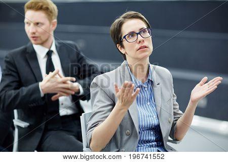 Tense broker looking at financial rating