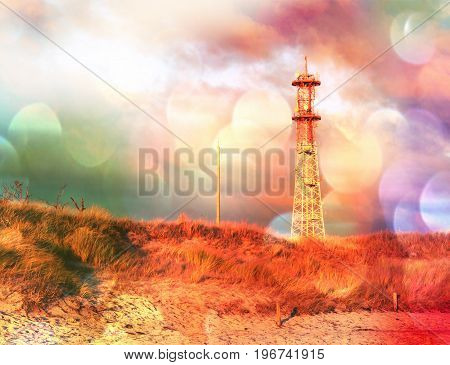 Film Effect. Meteorological Tower Station, Steel Construction At Sea Offshore. Dunes With Dry Stalk