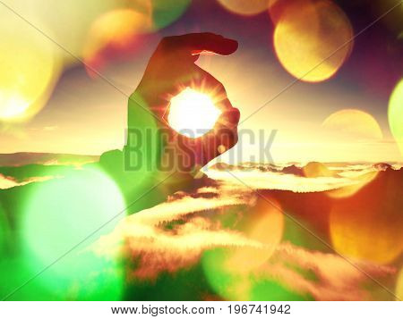 Film Effect. Man Hand Touch Sun. Misty Daybreak In A Beautiful Hills. Peaks Of Hills Are Sticking Ou