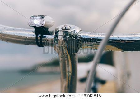 Bike Handlebars Close Up On The Beach