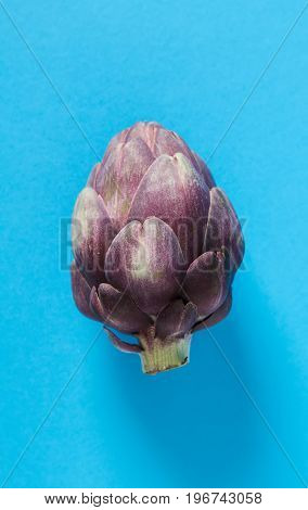 Baby Ripping Organic Artichokes. Food For A Vegan And A Vegetari