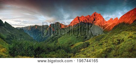 Amazing sunset and red afterglow in high mountains. Splendid alpenglow. Alps, Bavaria, Germany.