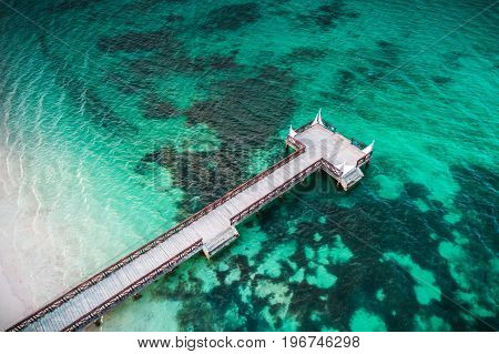 Aerial View Of Tropical Wooden Pier And Turquoise Caribbean Sea In Punta Cana, Dominican Republic