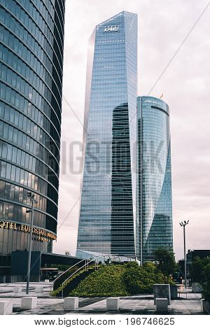 Madrid Spain - June 25 2017: Low angle view of skyscrapers in Cuatro Torres Business Area CTBA (Four Towers Business Area) a business district in Madrid against cloudy sky