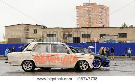Orel Russia July 22 2017: Dynamica car festival. Old Soviet car VAZ Lada with graffiti with industrial background