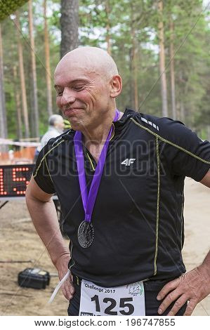 Saint-Petersburg Russia-July 08, 2017: Unknown Russia participant in the action Orehovo Triathlon Challenge 2017