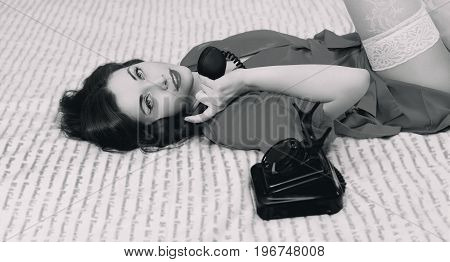 Beautiful Brunette Woman At The Bed In A Lingerie With A Vintage Telephone, Retro Black And White Ph