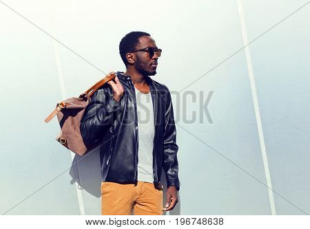 Fashion Portrait Confident African Man With A Bag In The City On A Copy Space Empty Grey Background