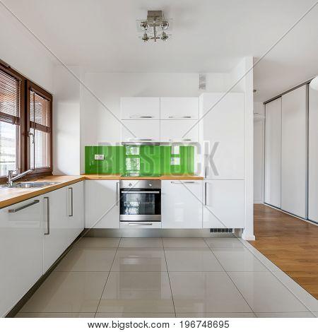 White, Open Kitchen With Window