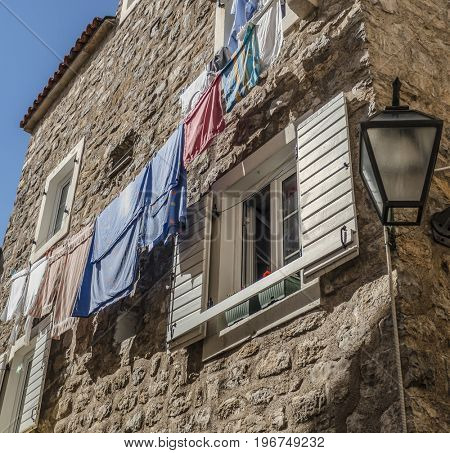 wooden windows with dry laundry