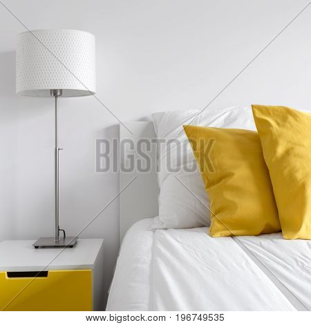 Bed And Yellow Side Table