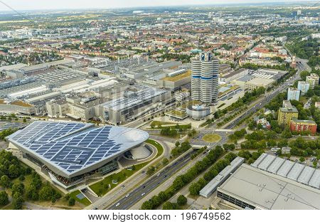 Evening view with BMW museum area seen from above from Olympia Tower on July 19 2015 in Munich Germany.
