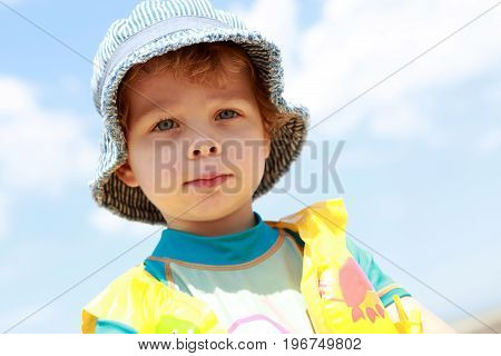 Portrait of a boy on sky background