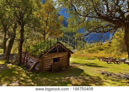 Old house near Briksdal glacier - nature and travel background