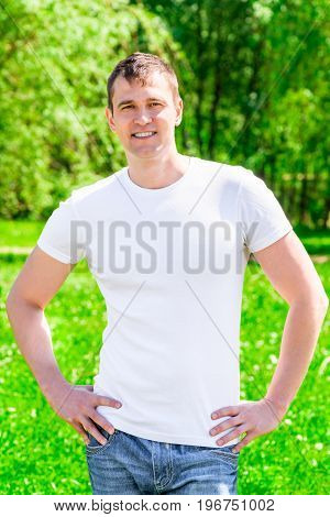 35-year-old Smiling Man In A T-shirt And Jeans In The Park